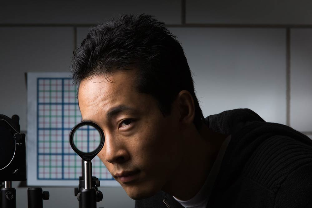 man looking through a lens and his eye appears to be missing