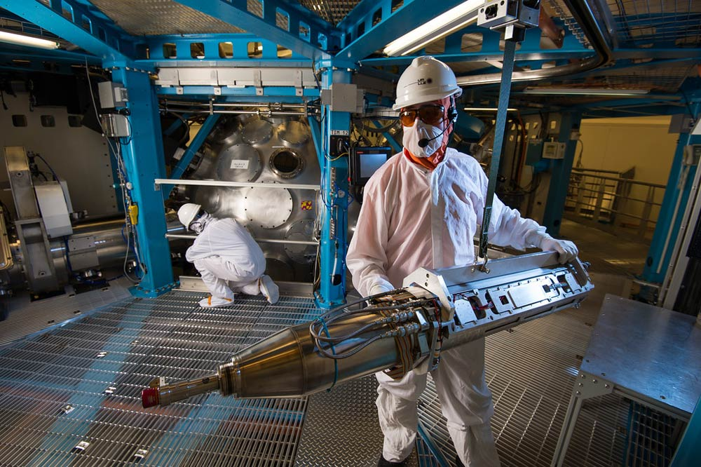 technicians working in clean suits in the Laser Lab