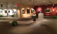 photo shows fans and other equipment in art gallery with sculptures