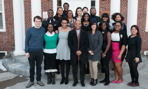 group portrait of speaker Khalil Muhammad with students