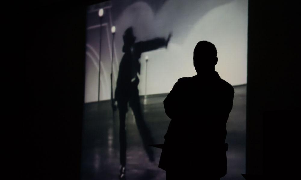 iportrait of Paul Burgett in silhouette.