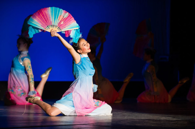 student performing with ornate fan