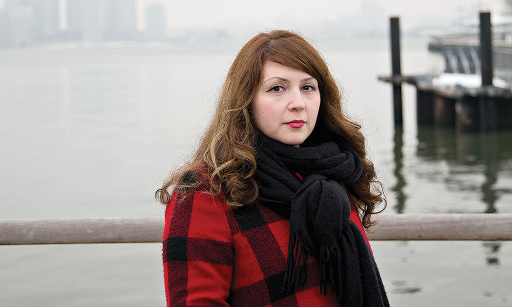 Meredith Dank standing on a pier in New York City