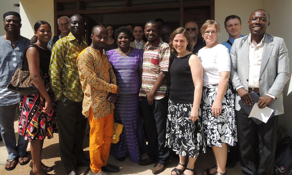 large group of faculty and students pose for a photo at the University of Ghana