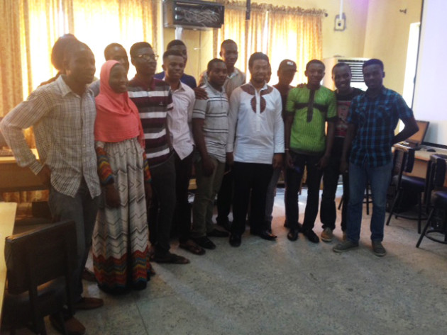 Abiola with students at the University of Lagos