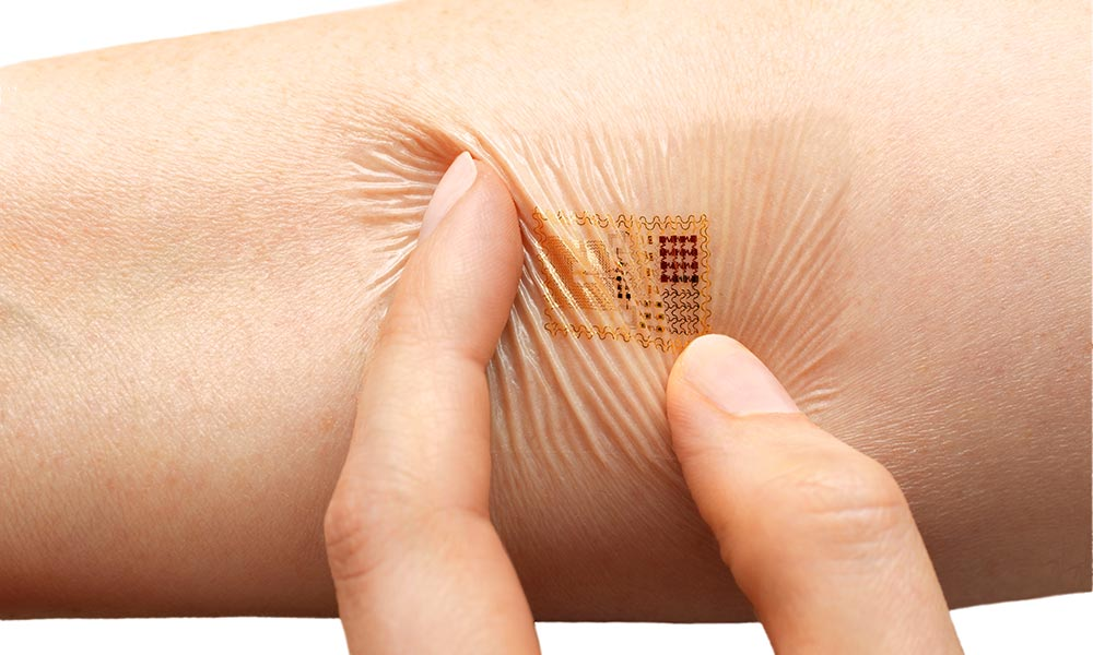 fingers twisting a slim, flexible biosensor sticker