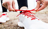 hands tying laces on a sneaker