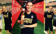 Dr. Bojan Zoric '98 holds one of the most famous trophies in the world (center), the FIFA Women's World Cup championship trophy. He is shown with two of the American stars - Carli Lloyd (l.) and Morgan Brian (r.)