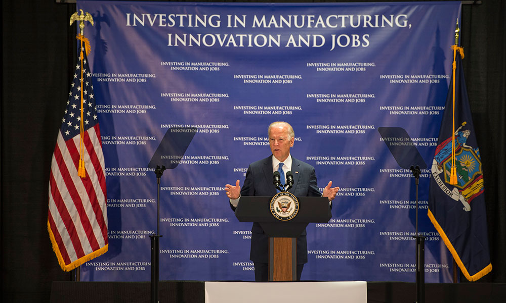 Vice President Joe Biden in front of backdrop that reads Investing in Innovation, Manufacturing, and Jobs