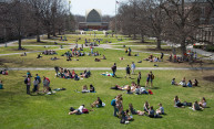 aerial photo of large group of students hanging out on the quad