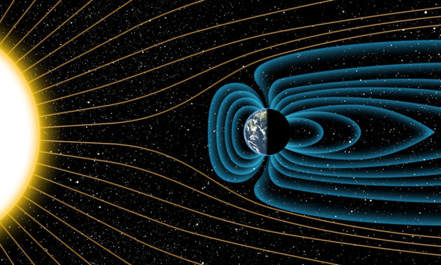 artist's illustration of the Earth's magnetic field deflecting energy from the sun