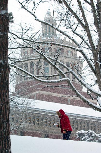 woman walking through a snowstorm