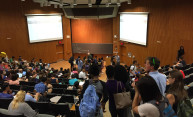 large group of students in a lecture hall