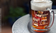 beer mug with Instagram photos floating in it and hashtags like booze, drunk, and alcoholicproz