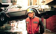 Michael J. Fox as Marty McFly poses with flying car