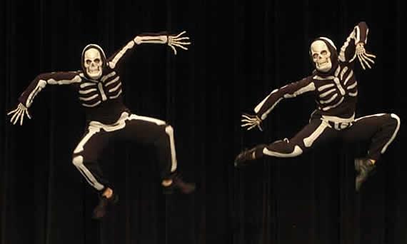 dancers dressed as skeletons
