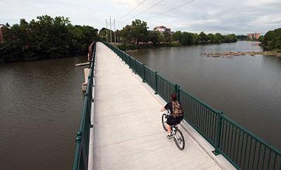 cyclist on pedestrian bridge