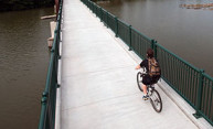 cyclist on pedestrian bridge