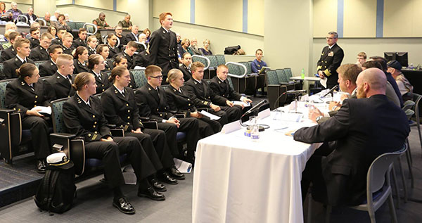 lecture class with NROTC cadets asking questions to a panel