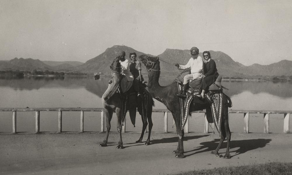 historical photo of people on camels