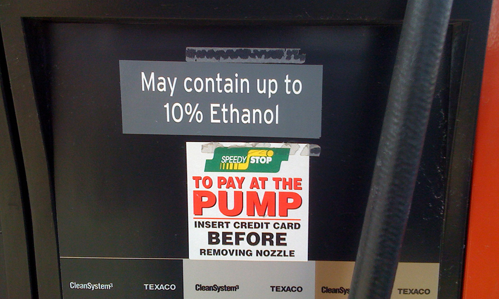 a gas pump with a sticker that says MAY CONTAIN UP TO 10% ETHANOL