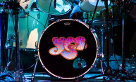 drum set features the logo for the band Yes