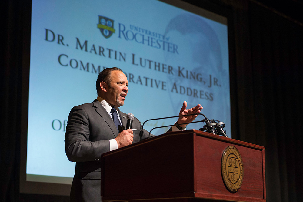 Marc Morial speaking before a photo of Martin Luther King