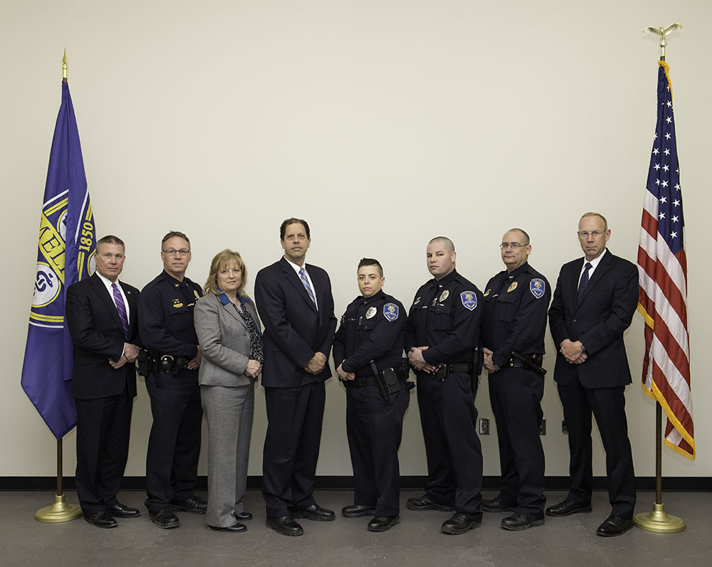 The Department of Public Safety team receiving the Meliora Award include: (from left) Deputy Chief Gerald Pickering, Commander Michael Epping, Investigator Lorraine Strem, Commander James Newell, Officer Tiffany Street, Officer Michael Fitzgerald, Commander Dana Perrin, and Chief Mark Fischer.