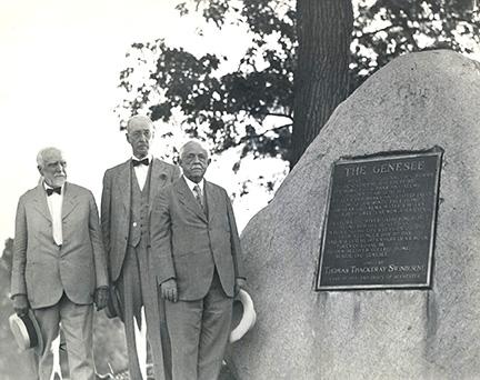 historic photo of men standing next to the Swinburn Rock