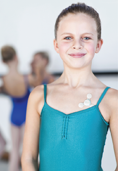 A young ballet dancers wearing a portable device for detecting asthma symptoms
