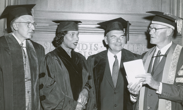 1957: President Cornelis de Kiewiet (right) talks with honorary degree recipients (from left) Willard M. Allen '32M (MD), famed singer Marian Anderson, and former New York governor and two-time presidential candidate Thomas E. Dewey, who presented the commencement address.