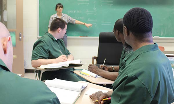 students and teacher in a prison classroom