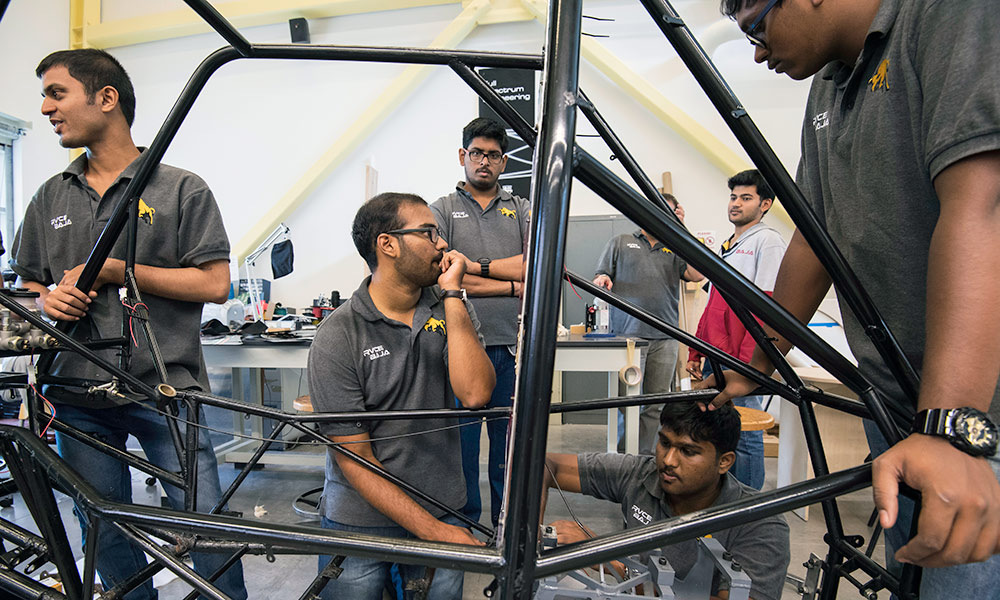 students from India assembling a Baja car