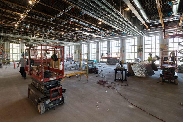 construction workers inside Frederick Douglass Building