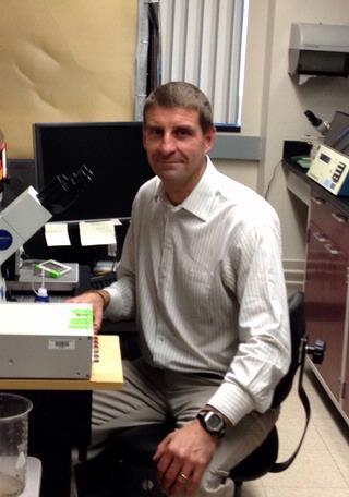 David Yule sits in a lab