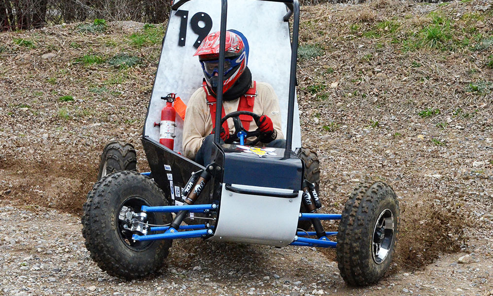 team member racing baja cart