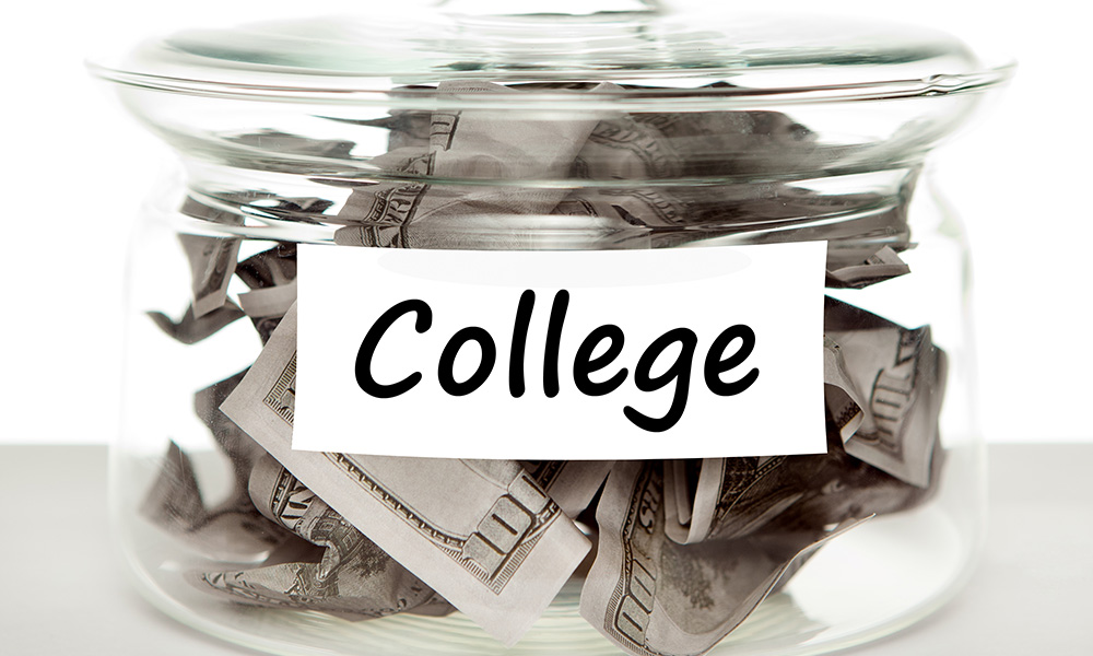 savings jar labeled COLLEGE with money inside