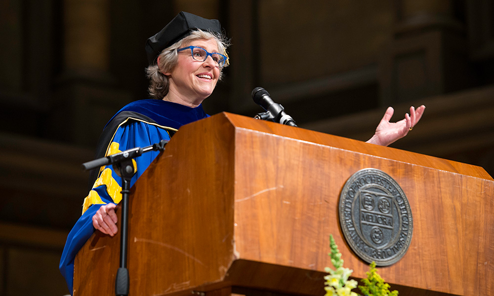 Mary Jo Heath behind podium delivering commencement address