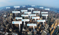 cutouts of tweets floating above a view of New York City
