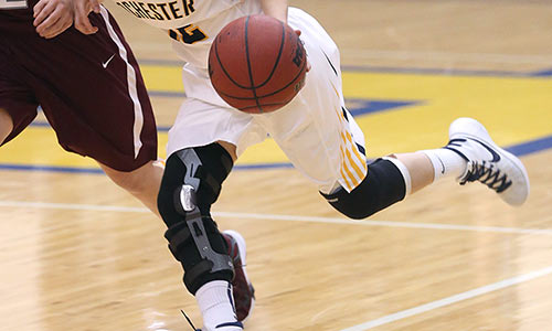 woman in knee braces playing basketball