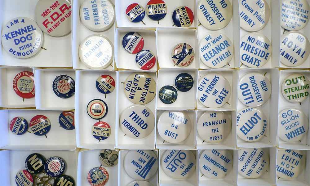tray of historical political buttons