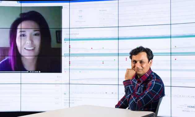 Ehsan Hoque in front of computer screen with inset of another person's face and data science content