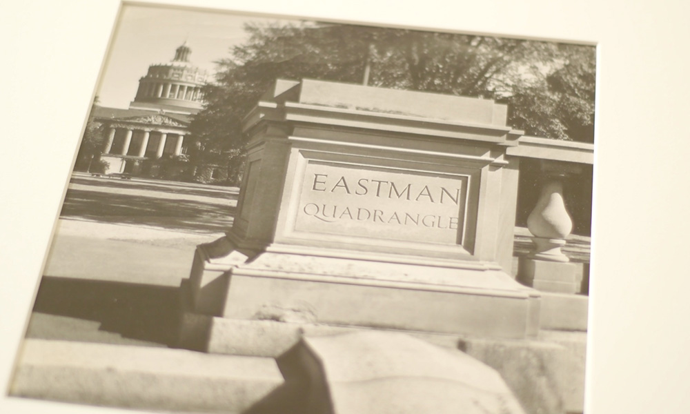 still from video showing photograph of Eastman Quad