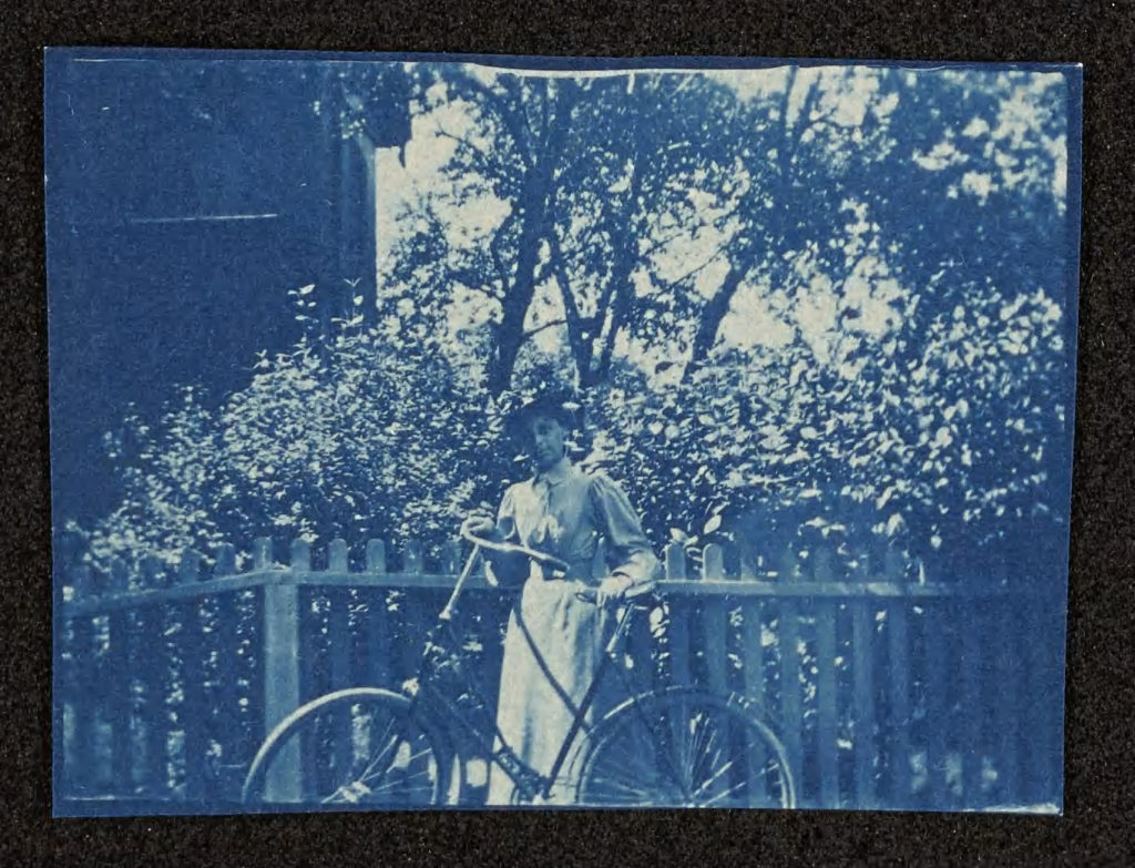 May Bragdon and her bicycle, Diana, in August 1895.