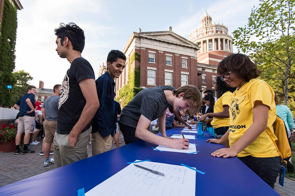 long line of students signing the class roll