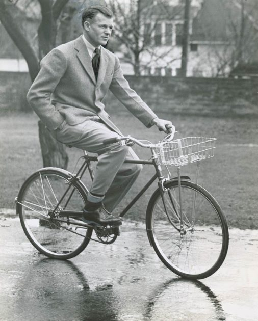 historic photo of man on bicycle