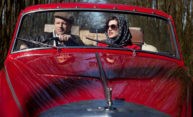 couple driving in classic car