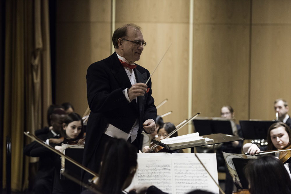 David Harman, professor of music leads the Chamber Orchestra during a practice before their concert in Strong Auditorium. J. Adam Fenster / University of Rochester