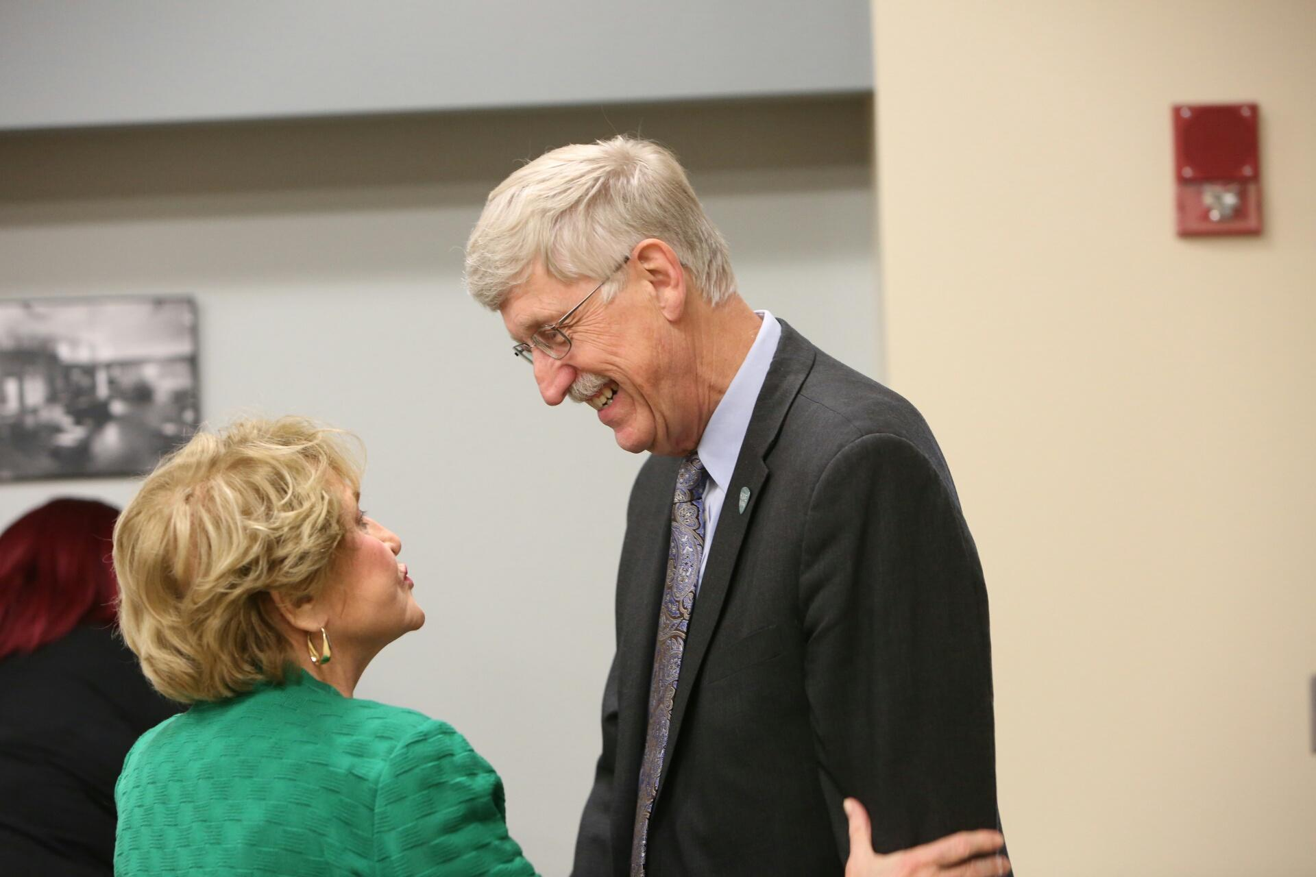 NIH director Francis Collins talks with U.S. Congresswoman Louise Slaughter.