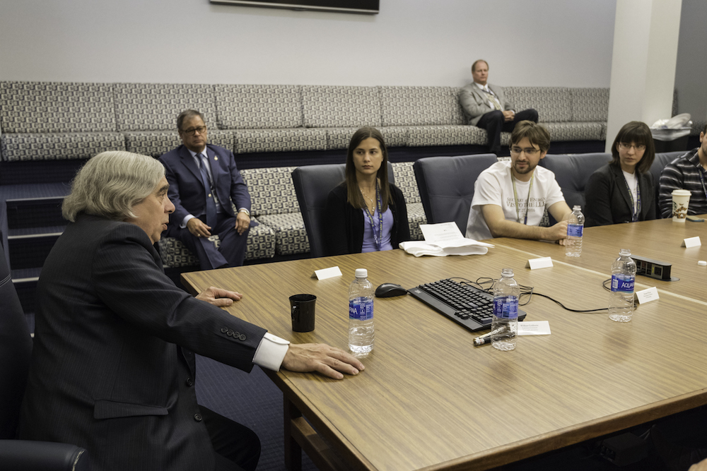 Ernest Moniz meets with students, including (from left) Katelyn Sharma, Andrew Davies, and Amanda Davis. (University photo/J. Adam Fenster)